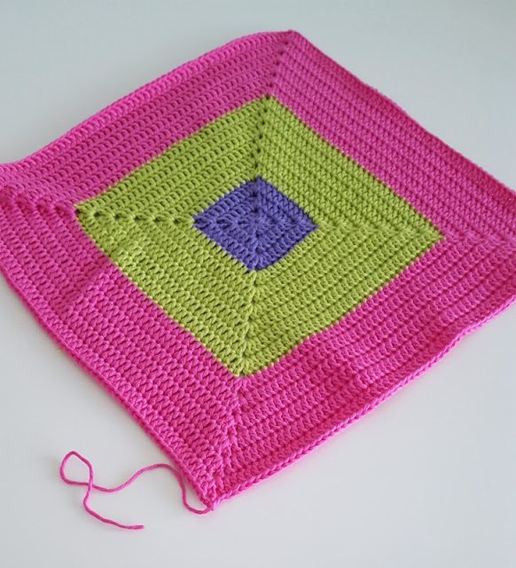 Colourful crochet square for a colour block blanket.