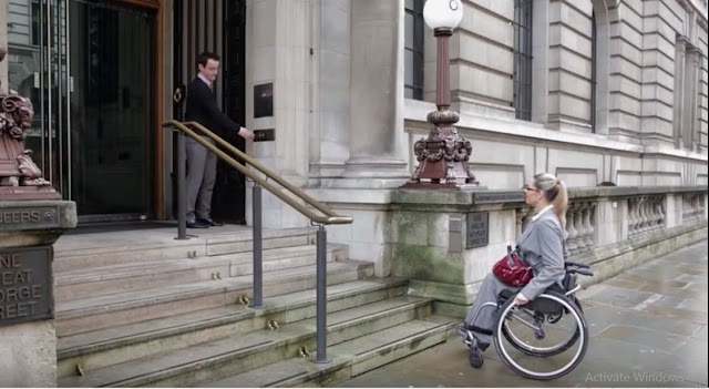 This Woman In A Wheelchair Is Trying Hard To Get Upstairs But You Will Not Believe What Happened When This Man Presses The Button!