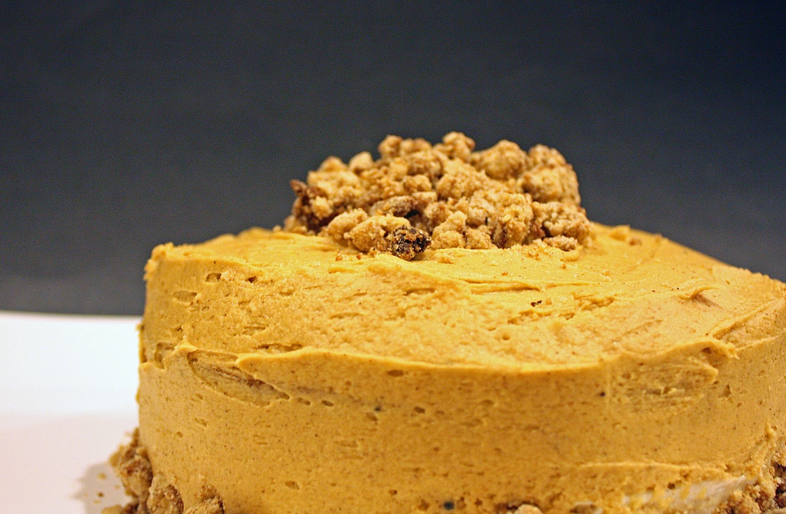 vegan maple gingerbread layer cake with cheesecake filling and spiced crumbs