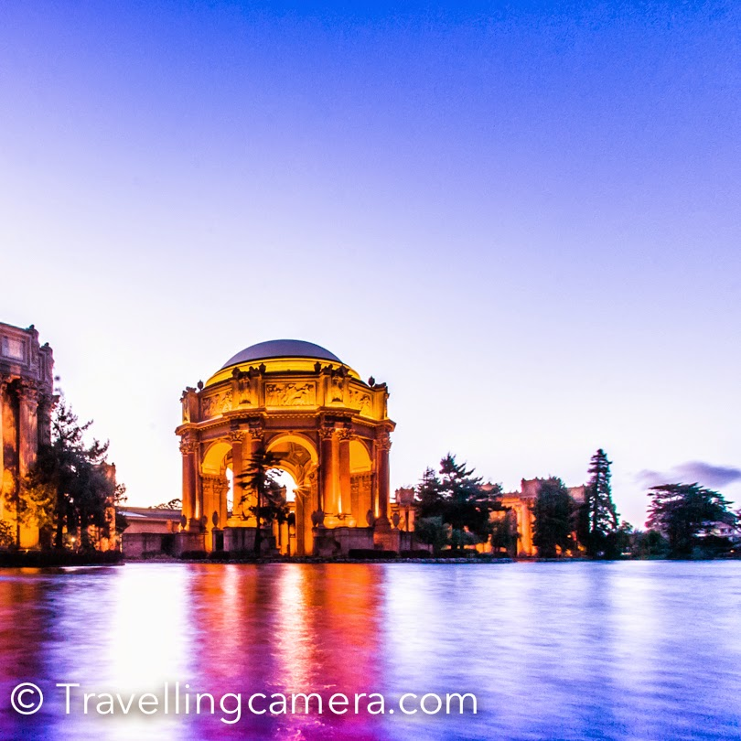 During my recent visit to San Francisco, I managed to take a quick tour of Palace of Fine Arts. It was late evening when I reached and before getting dark, I shot few shots of this beautiful building. This photo journey shares some information about the place and few shots. The Palace of Fine Arts is one of the most beautiful architectures in San Francisco and located quite close to Golden Gate Bridge. Last time when I visited San Francisco, we crossed through this building during the Photo Walk, but couldn't stop due to lack of time. This is located around a very nice neighborhood and there are some interesting walks. We walked around the streets for some time and then headed back to Union Square by taking bus. Bus is easily available for this place and the one which connects Union Square area, drops you at mission street.There is this beautiful water body in front of this marvelous building and few green parks around it. All these things make this place stunning. I don't really know what else can be done here during the day, but I would want to visit this place again during day and explore more.