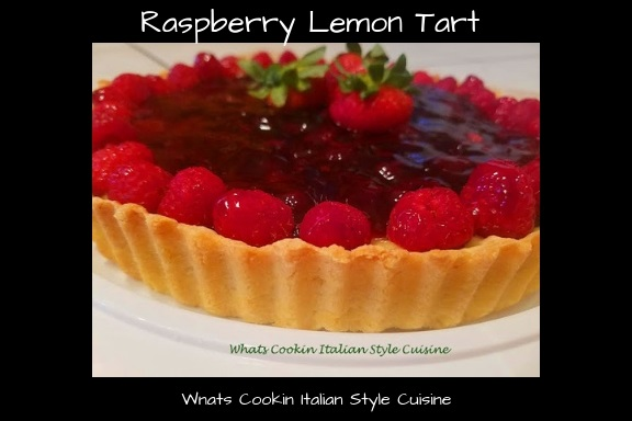 this is a lemon filled pastry tart with fresh red raspberries and raspberries puree on top.