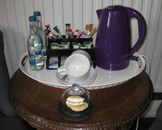 Shortbread cookies under a glass dome, ready for tea in my room, Oswestry, England