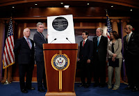 Senators Sheldon Whitehouse of Rhode Island, second from left, and Brian Schatz of Hawaii, third from left, hope to curry bipartisan support for a carbon tax as part of a larger deal on tax reform. (Credit: Carolyn Kaster/Associated Press) Click to Enlarge.