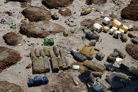 Bottles arranged on beach
