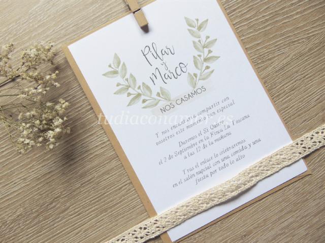 Una invitación de boda moderna y bonita con hojas pintadas de acuarela