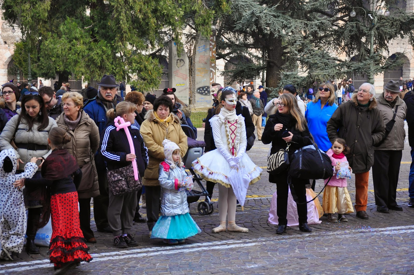 A ballerina girl and dressed up kids wait for the parade to start at Verona Carnival