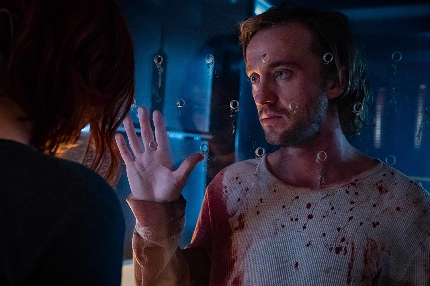 Tom Felton es Logan en Origin