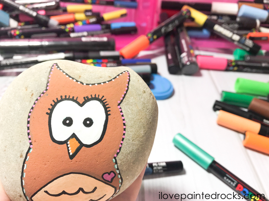 A owl painted rock which is super cute and easy to make with this step by step tutorial