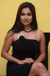 Vrushali Gosavi in strapless Short Black Dress At Follow Follow U Audio Launch 016.JPG