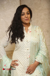 Actress Nithya Menen Latest Pictures in White Dress at 100 Days of Love Movie Audio Launch  0077.JPG