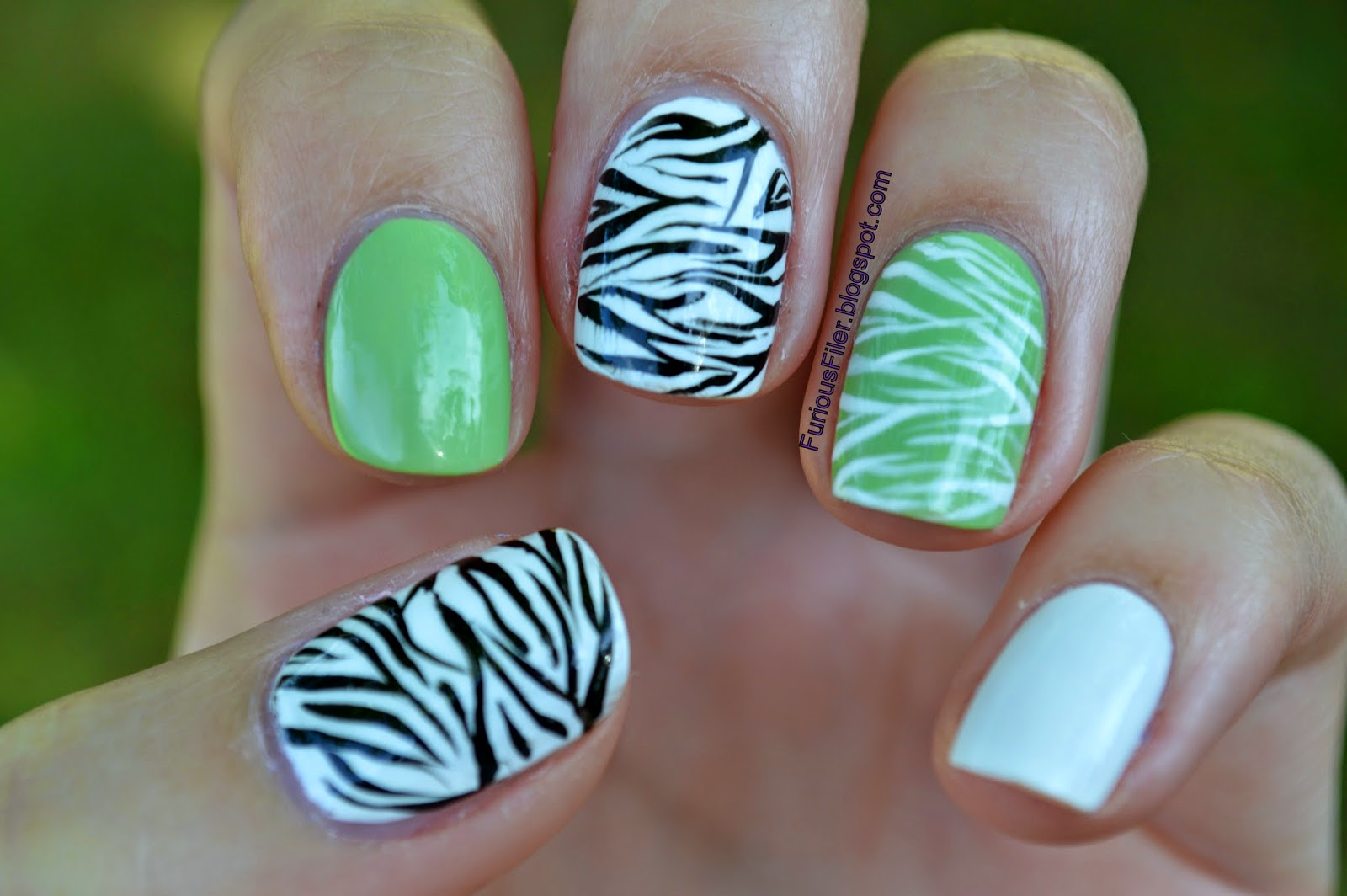 green and black zebra nail art