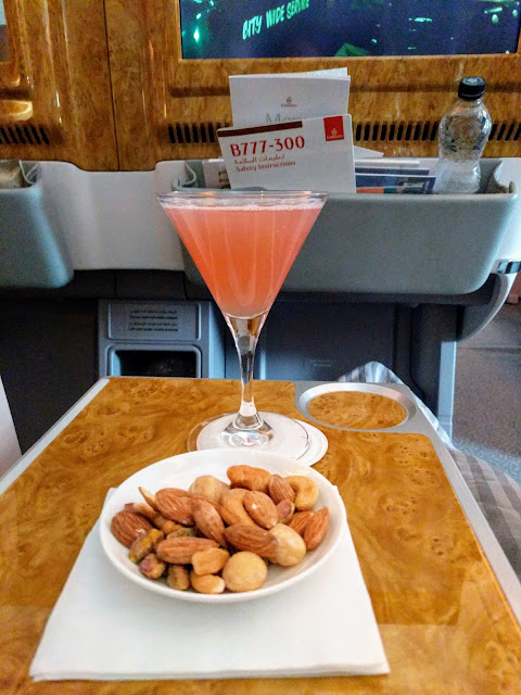 Cocktail and nuts aboard the Emirates Business Class 777 service