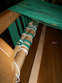 Warp threads attached to warp beam.