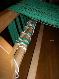 Warp threads attached to warp beam.