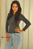 Actress Bhanu Tripathri Pos in Ripped Jeans at Iddari Madhya 18 Movie Pressmeet  0012.JPG