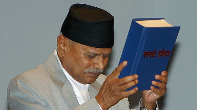Image Attribute: Nepalese President Ram Baran Yadav with the Constitution / Source: Creative Commons