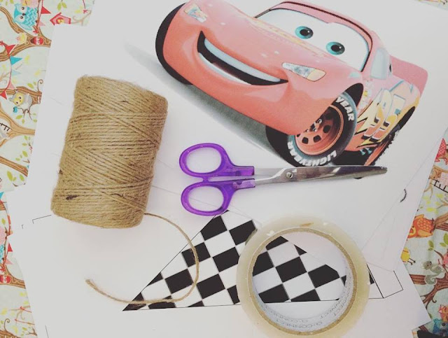 Lightning McQueen picture with scissors, string and tape