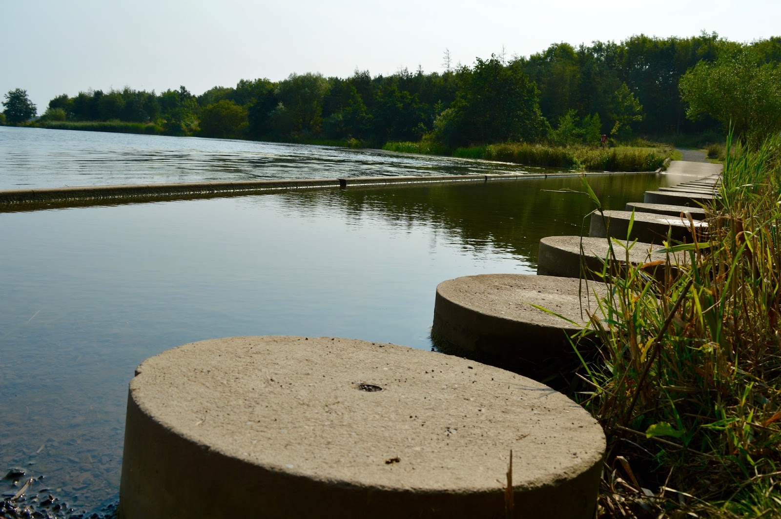 A walk around Ladyburn Lake at Druridge Bay Country Park | Northumberland - stepping stones across lake