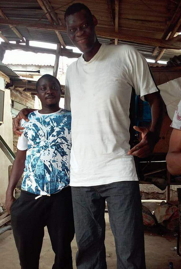 See the man who is POSSIBLY the tallest in Nigeria