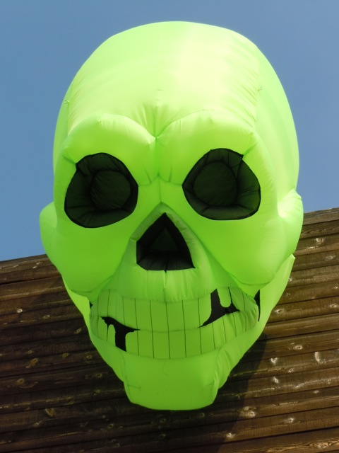 Inflatable green Halloween skull