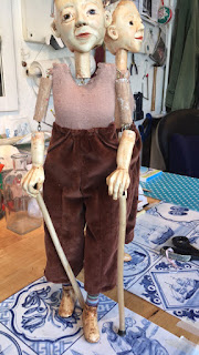 puppet leaning on her walking sticks, Puppet by Corina Duyn