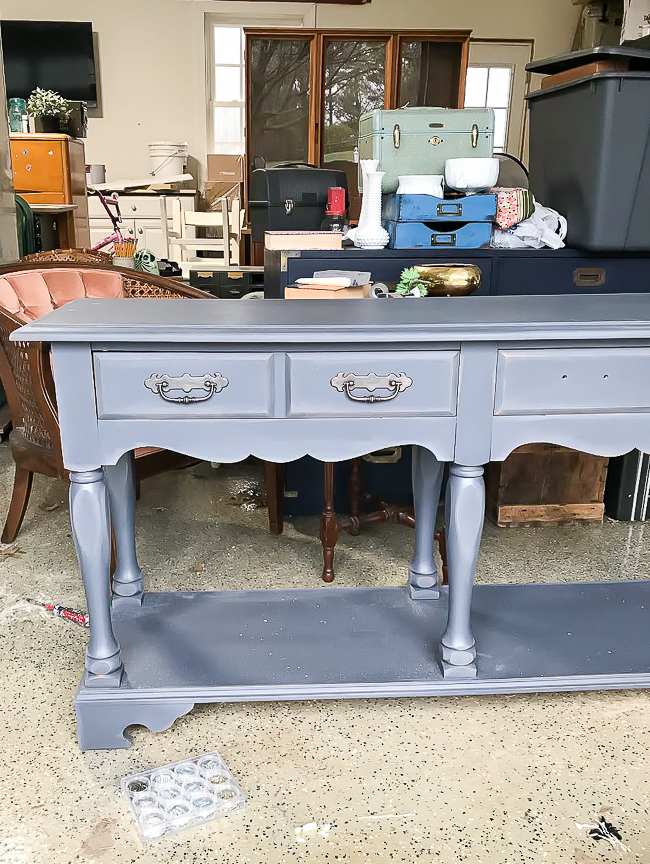 Dark gray base coat on dated console table