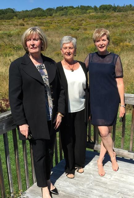 three woman on a deck