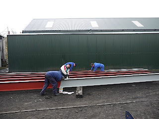Painting girders for Houghwell Burn Bridge East Tanfield