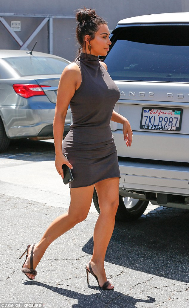 Kim Kardashian bares curves in turtleneck mini dress in LA