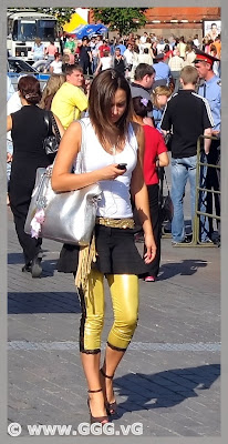 Girl in yellow breeches on the street