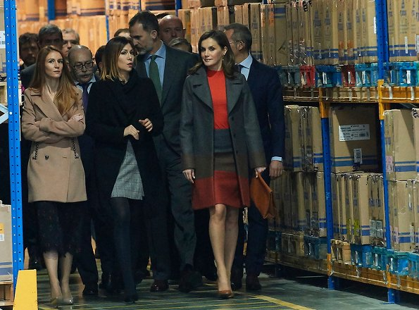 Queen Letizia wore Hugo Boss colorina wool blend cashmere striped coat and skirt and she wore Uterqüe pumps, Tous earings at Joma Sport