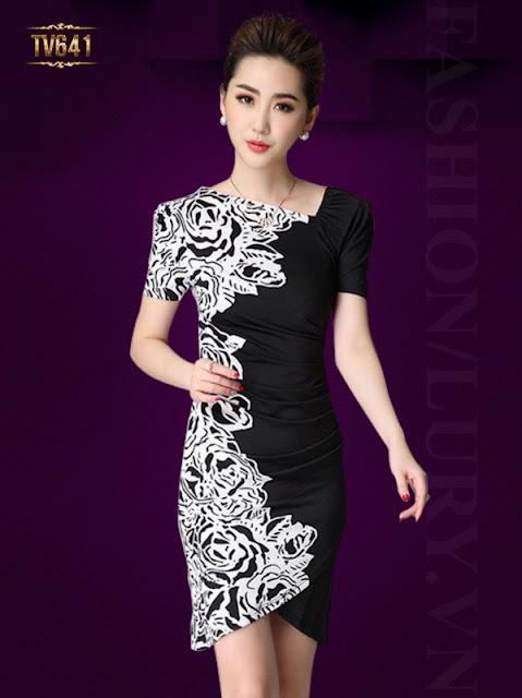 Họa tiết trang trí nổi bật giữa tông trắng và tông đen cho ra bộ váy đầm cực kì hoàn hảo