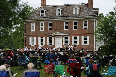 Orchestra concert on lawn in front of Historic Hope Lodge