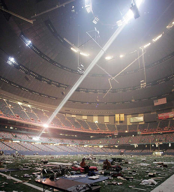 "Interior of the Louisiana Superdome in New Orleans, after housing refugees of Hurricane Katrina ""in lawless squalor"" (September 2, 2005) Photograph by James Nielsen"