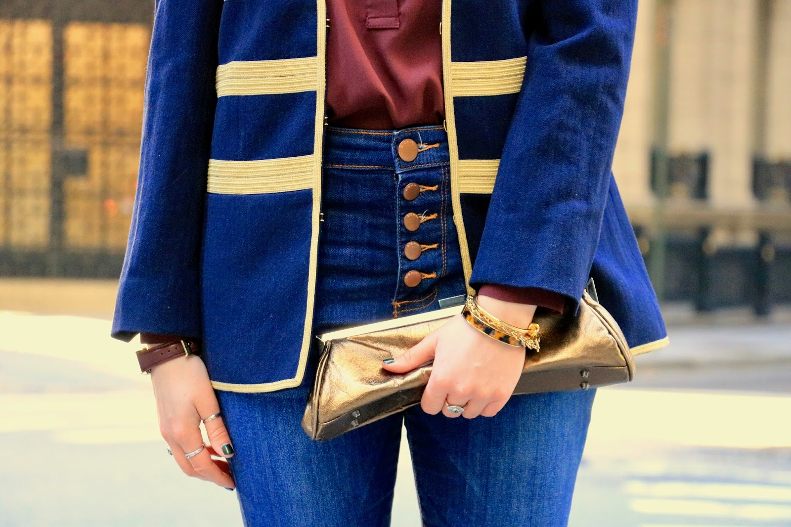 Nyc fashion blogger Kathleen Harper wearing a metallic bronze clutch