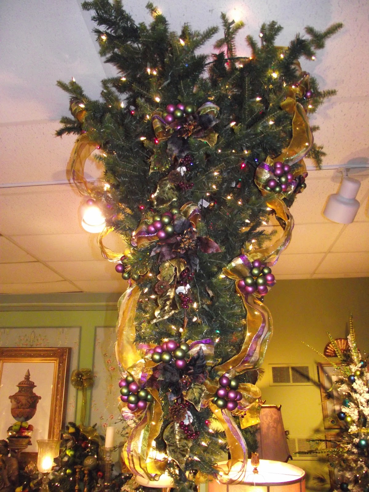 Decorating An Upside Down Christmas Tree In Purple Olive