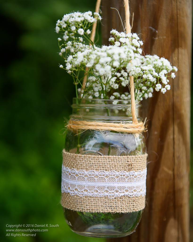 a photo of a glass mason jar holding wildflowers
