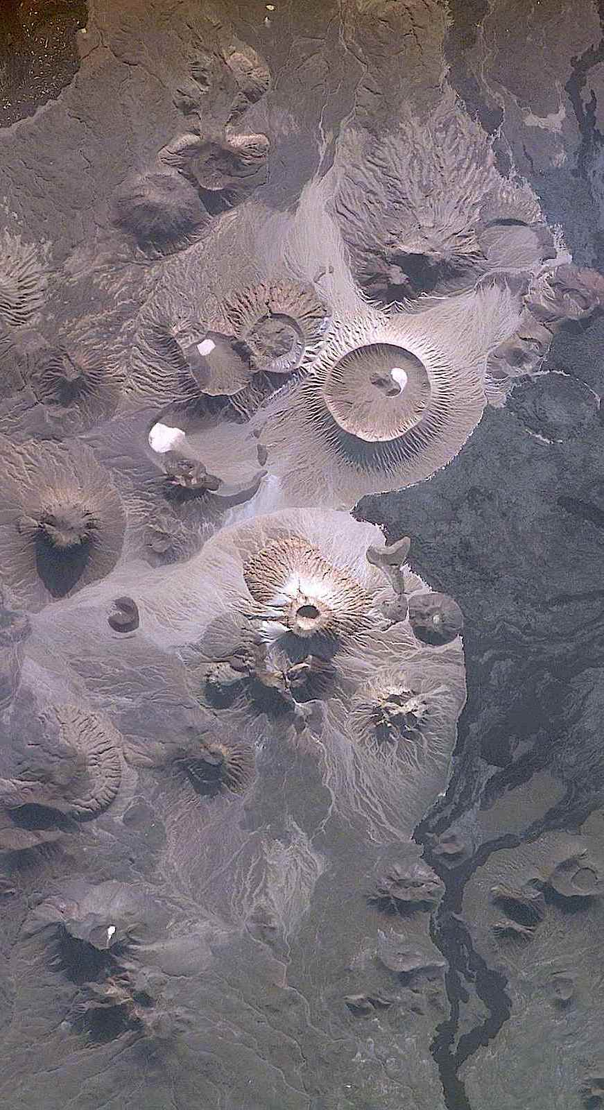 the lunar surface from above, a color photograph