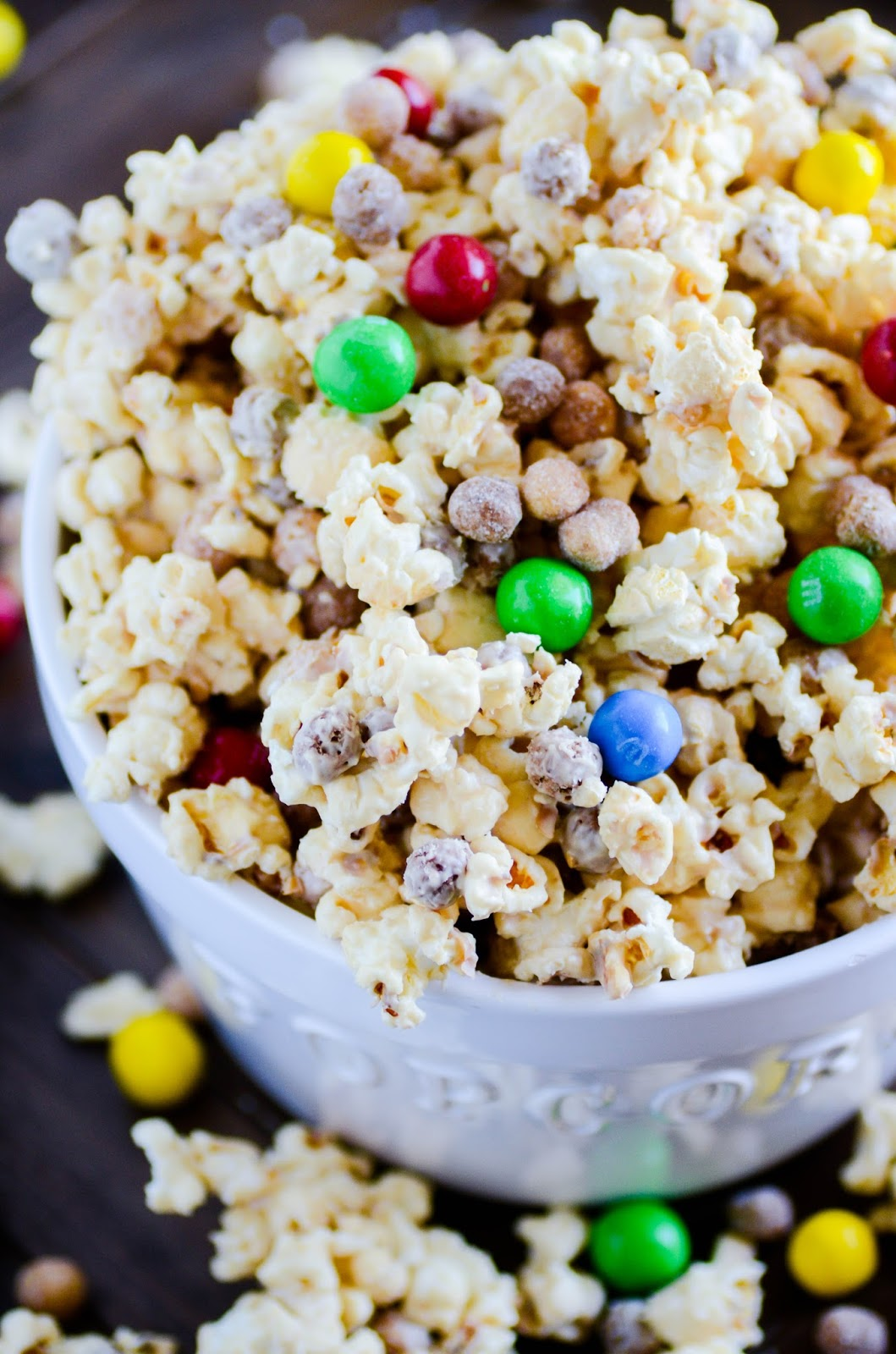 Crunchy, creamy, sweet and peanut butter-y snack mix filled with Reese's Puffs, kettle corn, and Pretzel M&Ms. Ready in under 30 minutes, and you won't be able to put it down!