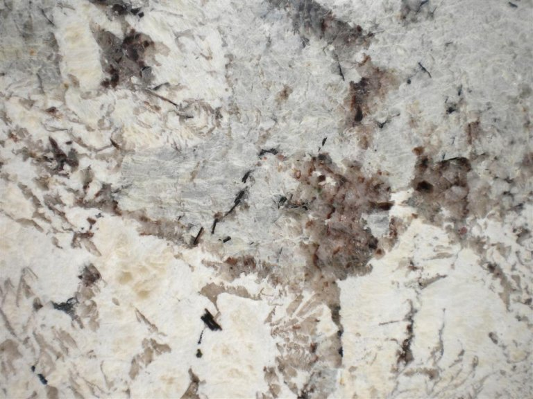 Delicatus white granite price living rooms gallery for Granite countertops colors price