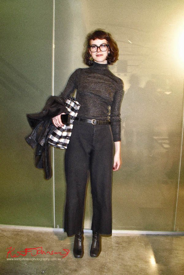 Loose bob cut, Black and silver lurex skivvy with baggy black pants, oversize glasses - Stills Gallery. Street Fashion Sydney by Kent Johnson.