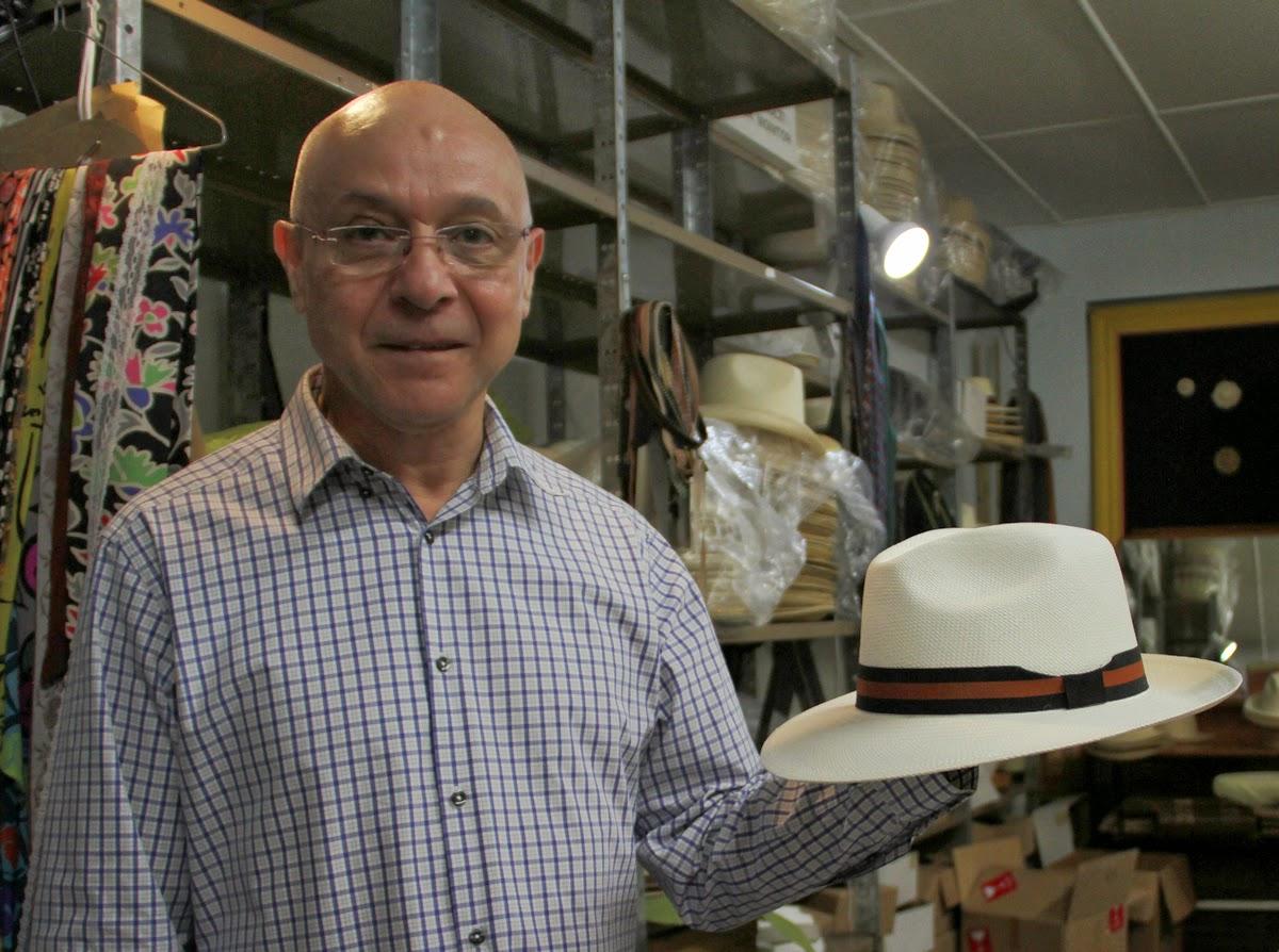 c8bad859ce1 Camilo Haffar holds a traditional woven cream panama hat