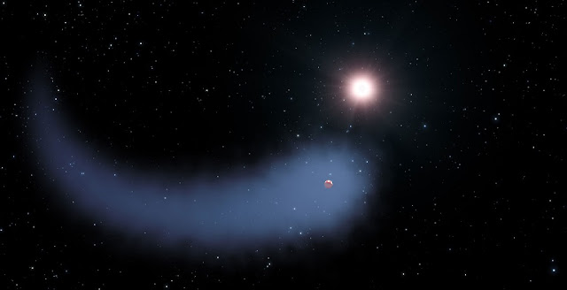 Artist impression of Gliese 436b shows the enormous comet-like cloud of hydrogen boiling off. Credit: NASA, ESA, STScI, and G. Bacon