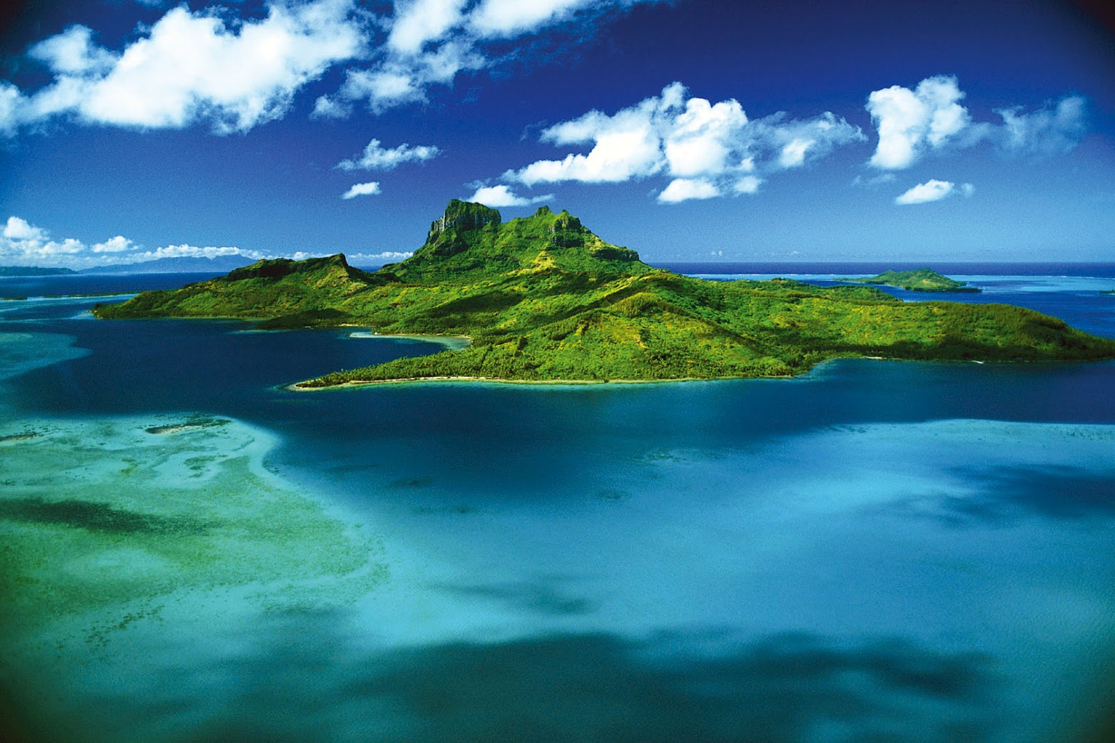 A Stunning View Of Bora From The Air Where You Can See Lofty Extinct Volcanoes Mount Pahia And Otemanu In Centre Island Which