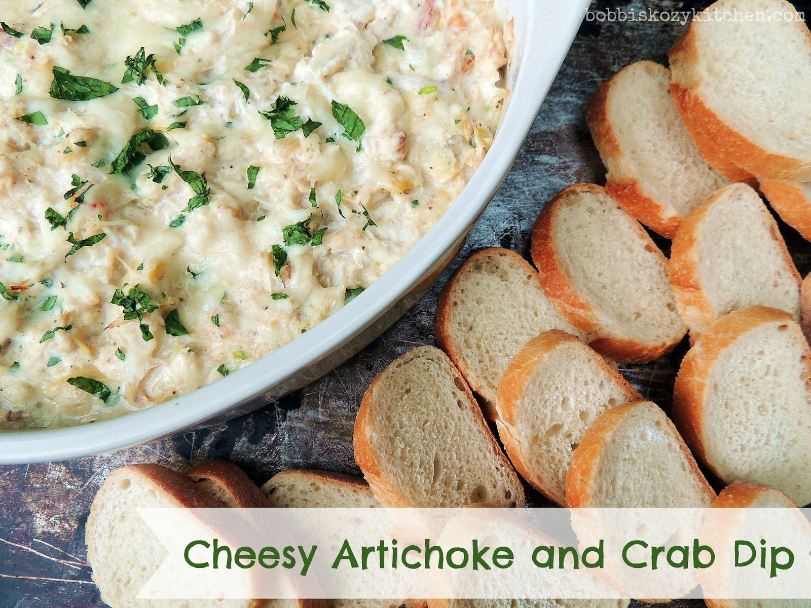 If you are looking for an appetizer that is sure to impress, this Cheesy Artichoke Crab Dip is it. Warm and cheesy, with tender artichoke hearts and luscious crab, your guests will be fighting for the last bite! From www.bobbiskozykitchen.com #appetizer, #crab #dip