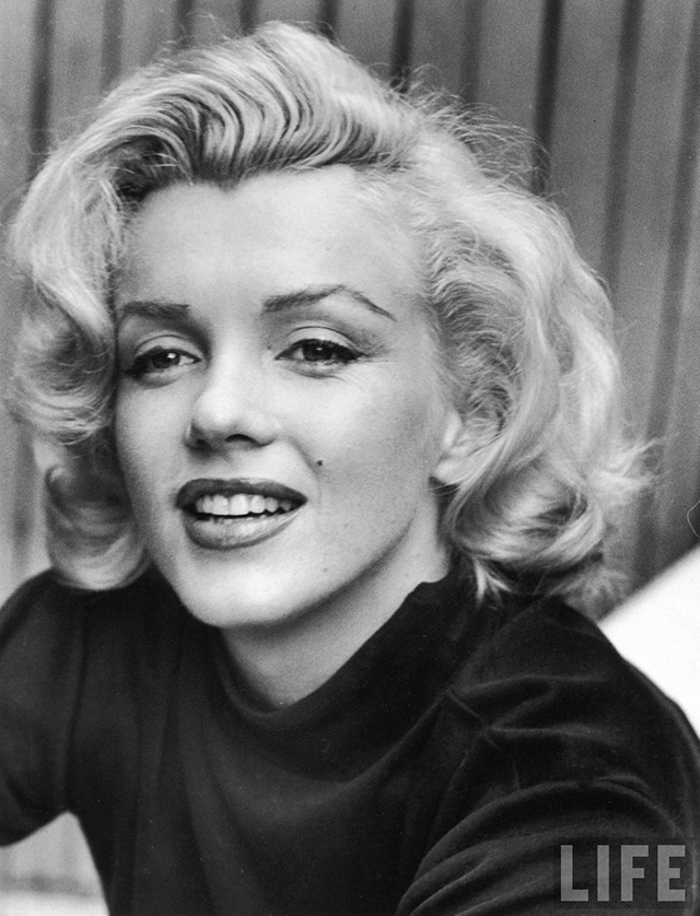 My favorite picture of marilyn hangs always on the wall in my office it was taken on the little patio of her hollywood house