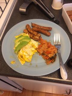 breakfast of eggs, sausage, avocado and kimchi