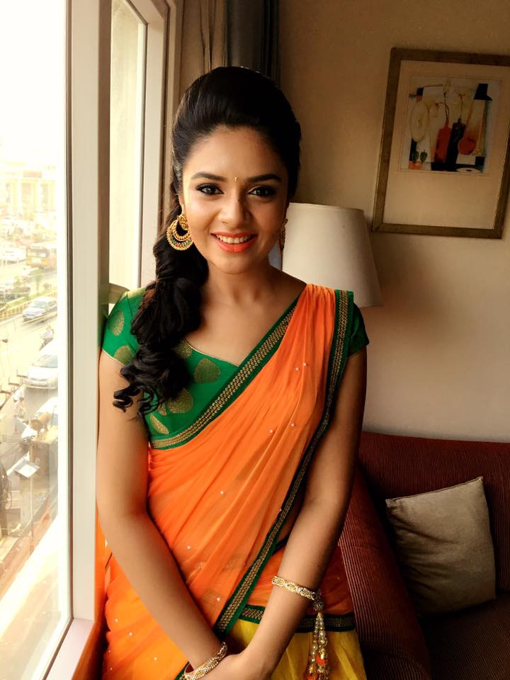 Tv anchor Sreemukhi Stills In Yellow half Saree