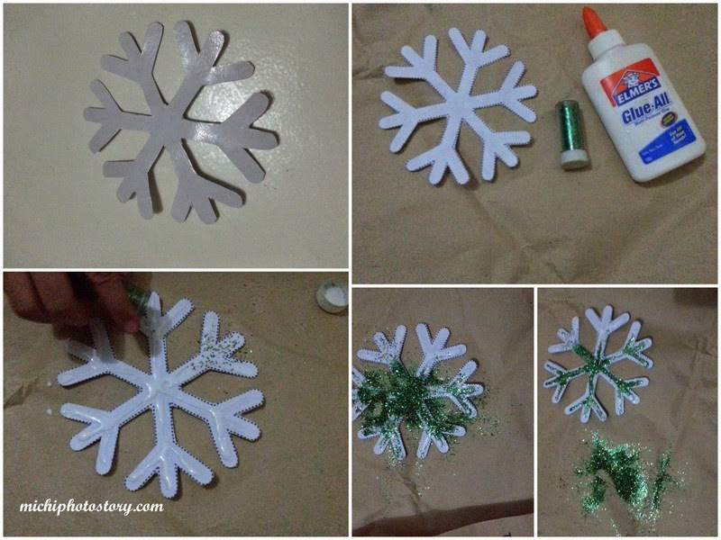 cut the snowflake put glue and i let my son put all the glitters i only have gold and green glitters and my son chose green