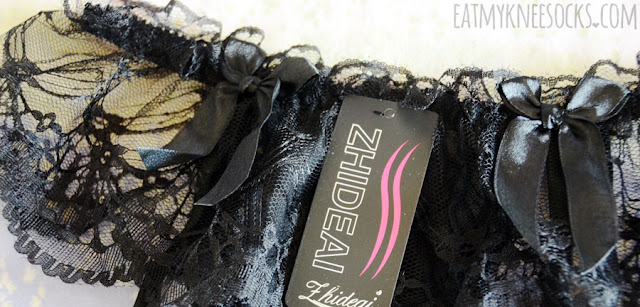 Details on the lace-trim black thong garter panties from Dresslink, perfect for adding a sexy accent under a skirt or dress.